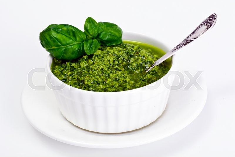 Stock image of 'Pesto Sauce with Basil on white Plate. Studio Photo'
