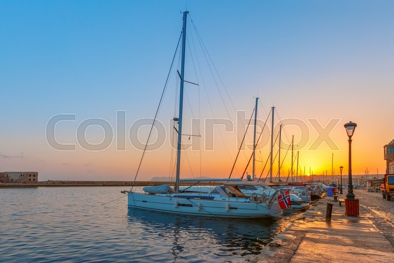 Stock image of 'Old harbour with fishing boats and marina of Chania at dawn, Crete, Greece'