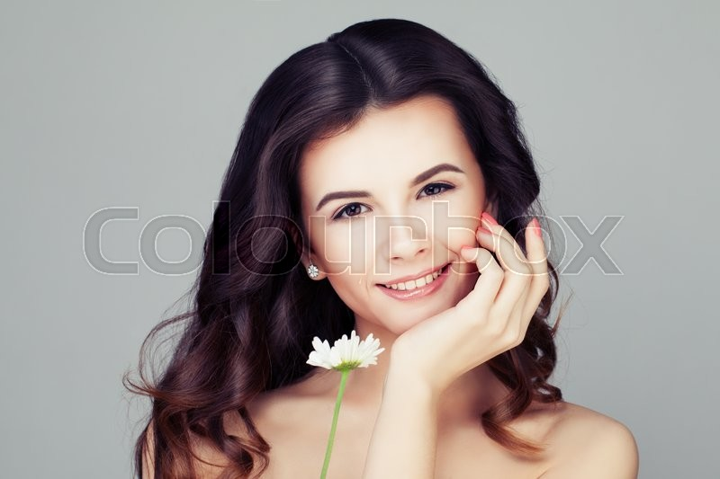 Stock image of 'Smiling Woman with Healthy Hair. Wavy Hairstyle and Clear Skin'