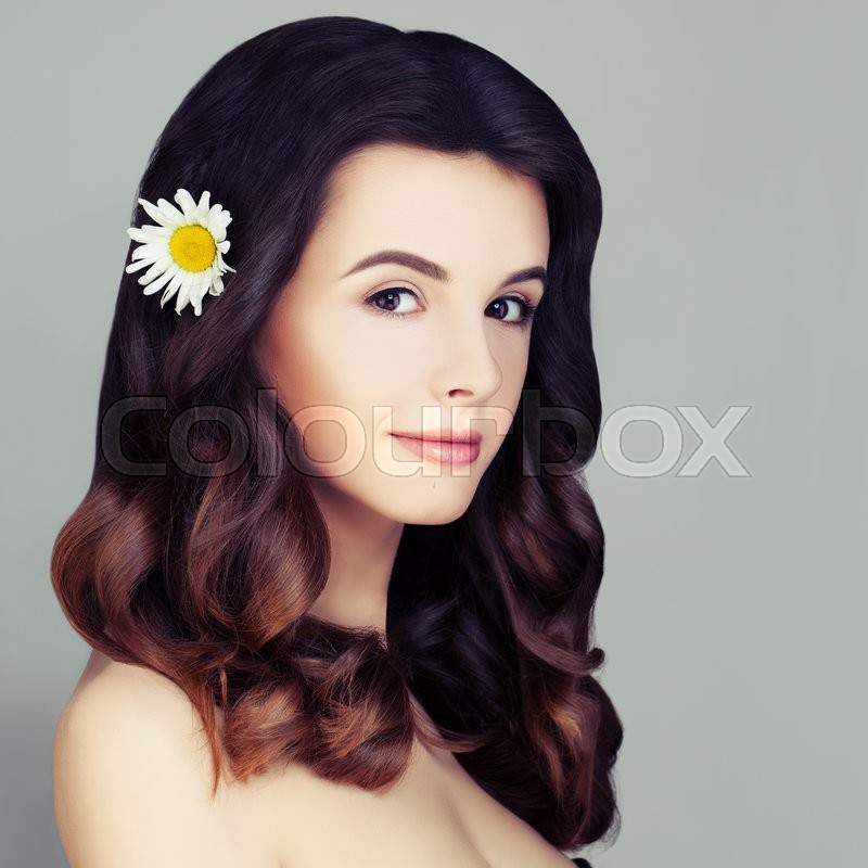 Stock image of 'Gorgeous Fashion Model Woman. Healthy Curly Hair with Ombre Hair Coloring and Natural Makeup'