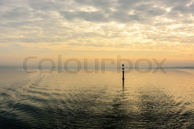 Stock image of 'Beautiful wake from sailboat in the early morning hours. Boy'