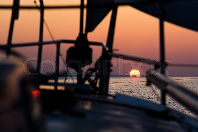 Stock image of 'Sailing to new destinations during sunrise'