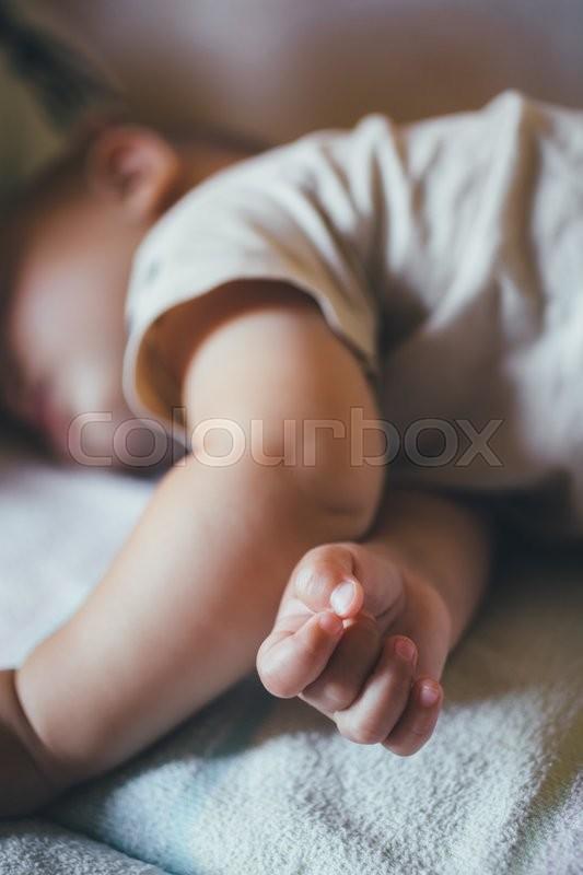 Stock image of 'small child sleeps soundly during the day. Close-up'