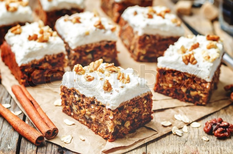 Stock image of 'vegan walnuts carrot cake with cashew cream frosting. toning. selective focus'