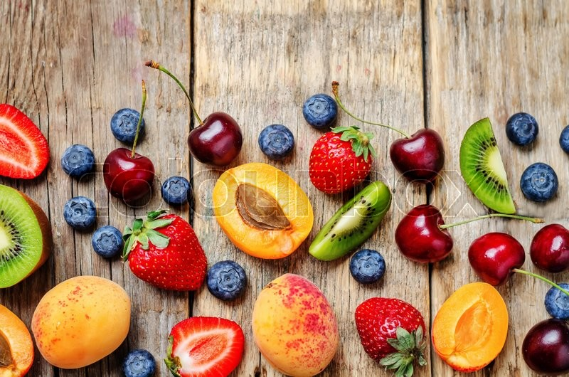 Stock image of 'fruits and berries on a dark wood background. the toning. selective focus'