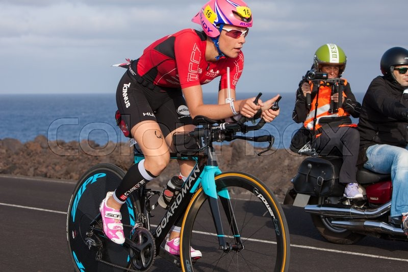 Editorial image of 'LANZAROTE, SPAIN - MAY 21: Sportsman Lucy Charles (16, GBR)rides a bike during the IRONMAN LANZAROTE triathlon on May 21, 2016 in Tamanfaya, Lanzarote, Las Palmas, Canary Islands, Spain'