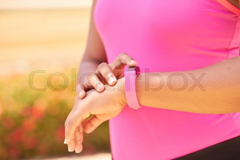 Stock image of 'Young people doing sport activities, woman runner jogging using fit watch. Concept of leisure, health, recreation, fitness, lifestyle, exercising, training, workout'
