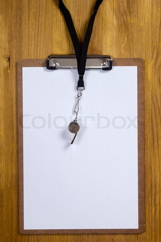Stock image of 'Whistle and paper for sports tactics on a wooden background'
