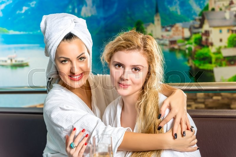 Stock image of 'Young and beautiful girlfriend hugging after spa'