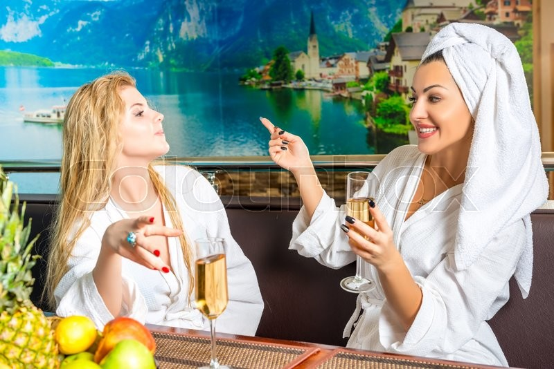 Stock image of 'Female communication after spa treatments in the sauna'