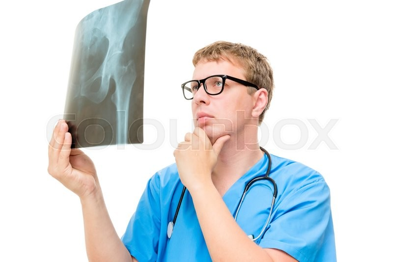 Stock image of 'Pensive doctor with X-ray in hands on a white background'