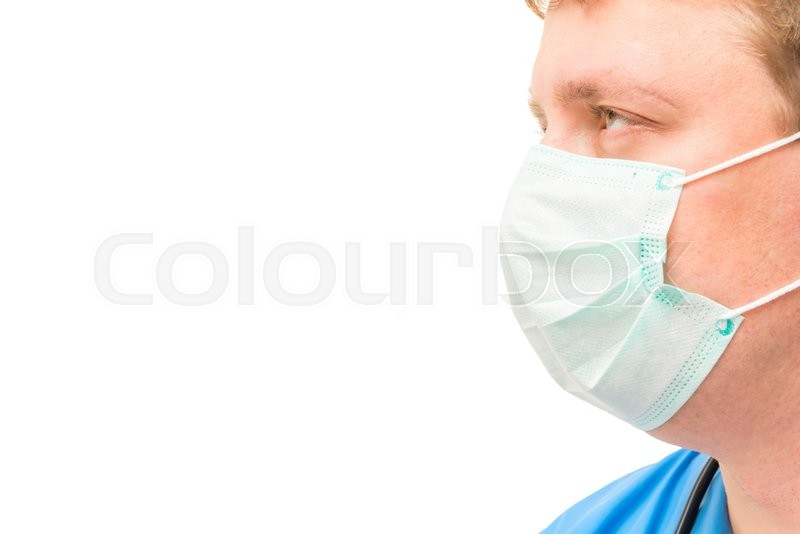 Stock image of 'Mask on the face of the surgeon and space for lettering close-up'