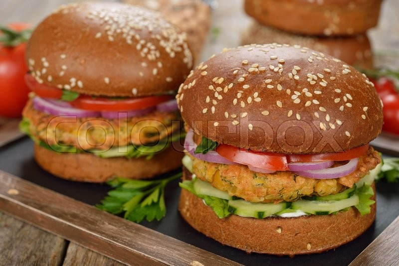 Stock image of 'Vegetarian burger on a wooden background'