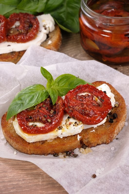 Stock image of 'Bruschetta with feta and sun-dried tomatoes slices spiced'