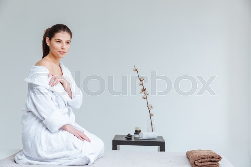 Stock image of 'Attractive gentle young woman in bathrobe sitting and waiting for mssage spa salon'