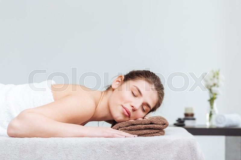Stock image of 'Tender woman lying during skin care treatment in spa salon'