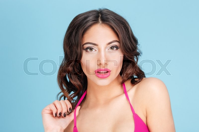 Stock image of 'Close-up portrait of a beautiful sexy girl isolated on the blue background'