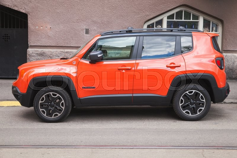 Editorial image of 'Helsinki, Finland - May 21, 2016: New shining red Jeep Renegade, side view. It is a subcompact crossover SUV  or mini SUV in Europe, produced by Jeep'