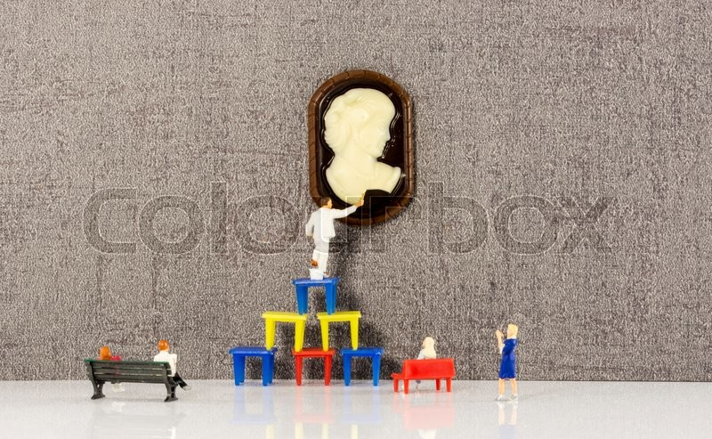 Stock image of 'little puppets in museum painting and restauration of modern art'