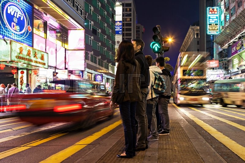 Editorial image of 'HONG KONG - FEBRUARY 21: Unidentified people crossing the street on February 21, 2013 in Hong Kong. With a 7 million people, Hong Kong is one of the most densely populated areas in the world.'