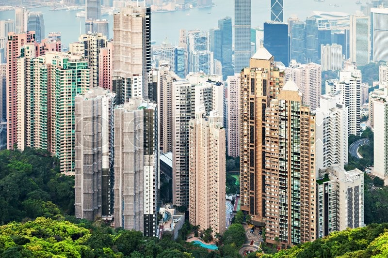 Editorial image of 'HONG KONG - FEBRUARY 22: Cityscape of Hong Kong island from Victoria peak on February, 22, 2013. The Victoria Harbour is world-famous for its stunning panoramic night view and skyline.'
