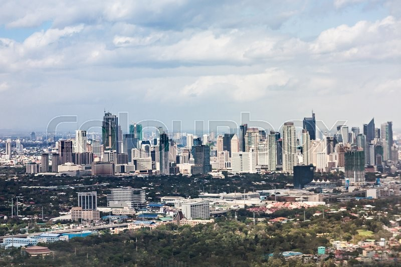 Editorial image of 'MANILA, PHILIPPINES - FEBRUARY 24: Makati skyline on February, 24, 2013, Manila, Philippines. Makati is a financial centre of Manila city with highest building in this region. '