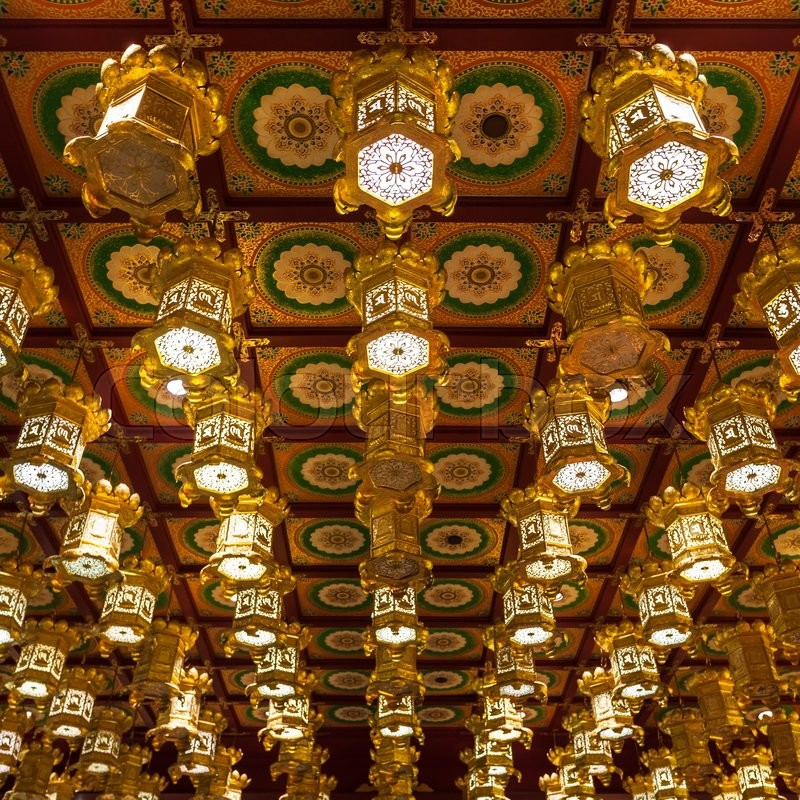 Editorial image of 'SINGAPORE - OCTOBER 16, 2014: Inside the Buddha Tooth Relic Temple. It is a Buddhist temple located in the Chinatown district of Singapore.'