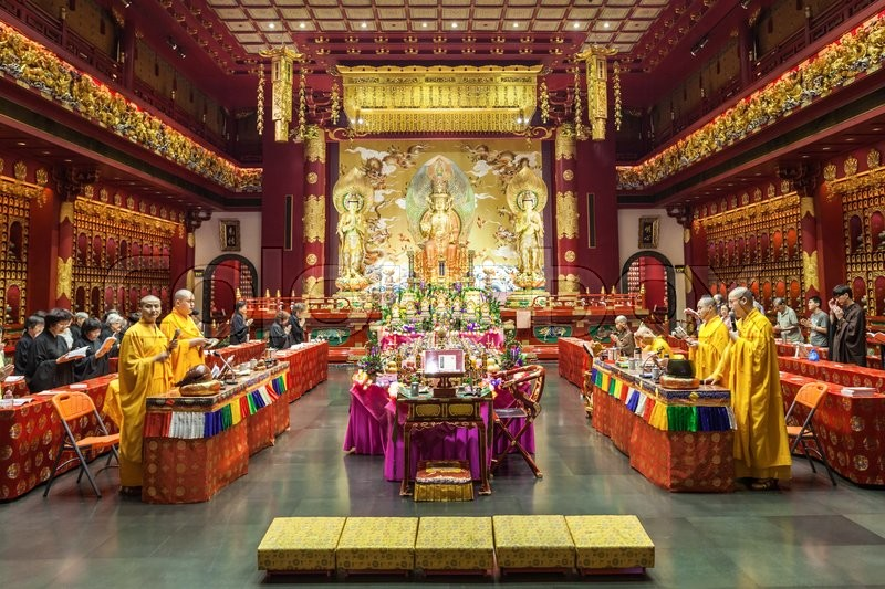 Editorial image of 'SINGAPORE - OCTOBER 16, 2014: Buddha Tooth Relic Temple interior. Its a main Buddhist temple in the Chinatown district of Singapore.'