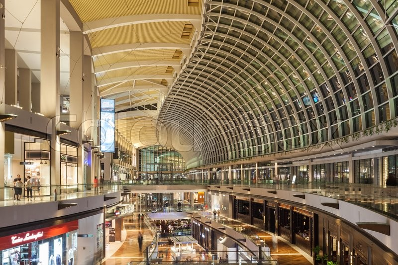 Editorial image of 'SINGAPORE - OCTOBER 16, 2014: The Shoppes at Marina Bay Sands is one of Singapore's largest luxury shopping malls, with over 800,000 square \feet of high-end retail shoppes.'