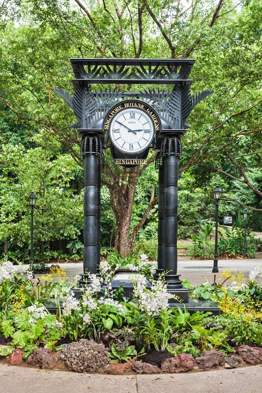 Editorial image of 'SINGAPORE - OCTOBER 17, 2014: Old Clock in The Singapore Botanic Gardens.'