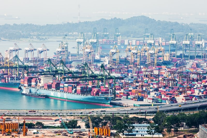 Editorial image of 'SINGAPORE - OCTOBER 18, 2014: The port of Singapore. It's the world's busiest transshipment port and the world's second busiest port in terms \of total shipping tonnage.'