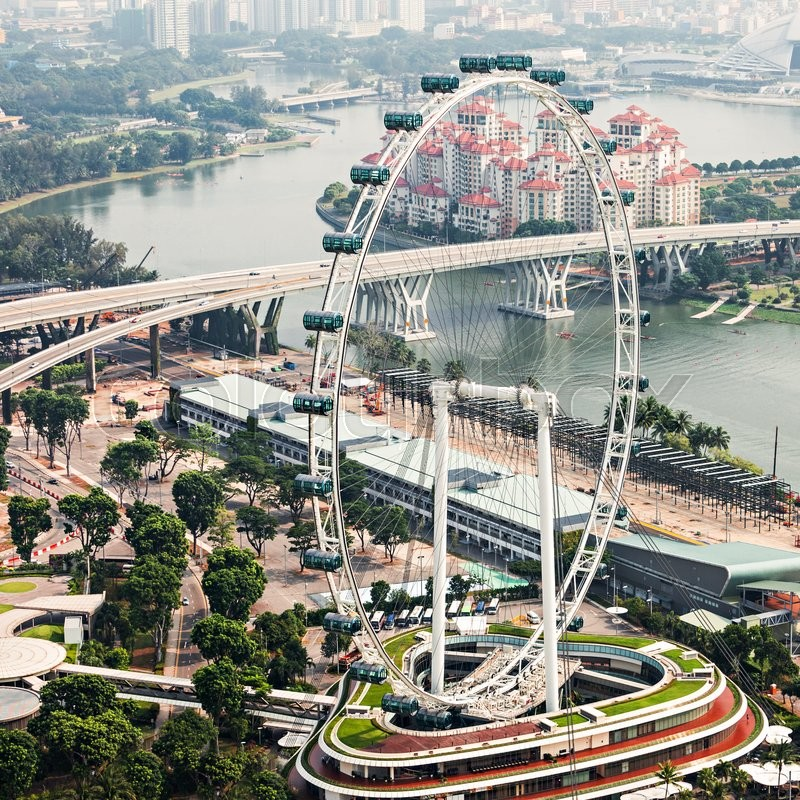 Editorial image of 'SINGAPORE - OCTOBER 18, 2014: Singapore Flyer, view from Marina Bay Sands Skypark.'