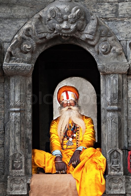 Editorial image of 'KATHMANDU - APRIL 15: Sadhu at Pashupatinath Temple in Kathmandu, Nepal on April 15, 2012. Sadhus are holy men who have chosen to live an ascetic life and focus on the spiritual practice of Hinduism'