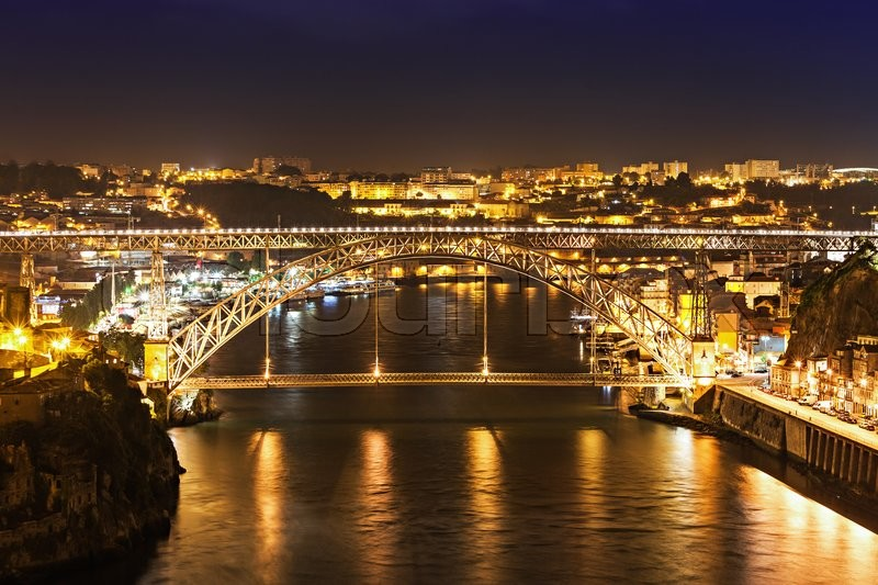 Stock image of 'The Dom Luis I Bridge is a metal arch bridge that spans the Douro River between the cities of Porto and Vila Nova de Gaia, Portugal'