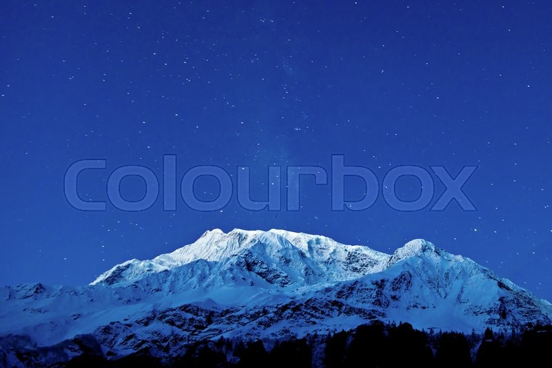 Stock image of 'Gangapurna and Annapurna mountains on the blue sky with stars, Himalaya, Nepal'
