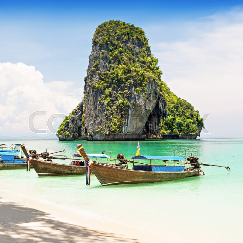 Stock image of 'Longtale boats at the beautiful beach, Thailand - focus on the boats'