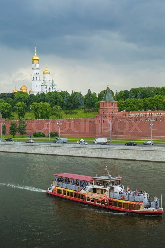 Editorial image of 'MOSCOW - JUNE 02: Kremlin embankment of the Moscow river. The towers and walls of Moscow Kremlin from the Moskva river on June 02, 2016'