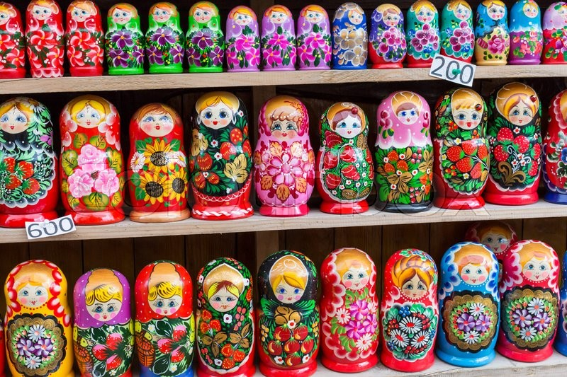 Stock image of 'Colorful Russian nesting dolls matreshka at the market. Matrioshka Nesting dolls are the most popular souvenirs from Russia.'