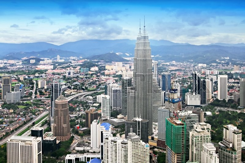 Stock image of 'KUALA LUMPUR, MALAYSIA - DECEMBER 18: Petronas Twin Towers panorama at morning on December 18, 2010 in Kuala Lumpur, Malaysia. Petronas Twin Towers were the tallest buildings (452 m) in the world from 1998 to 2004. '