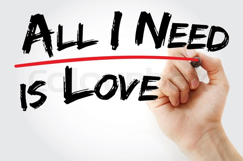 Stock image of 'Hand writing All I need is love with red marker, concept'