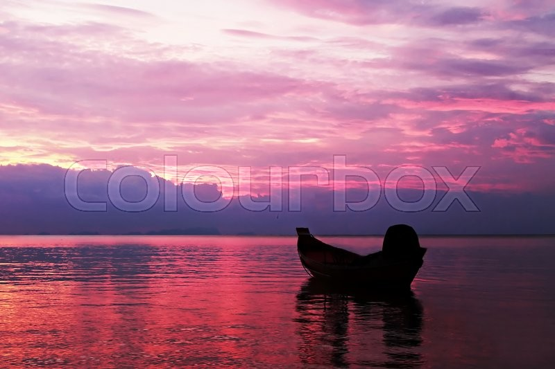 Stock image of 'Boat in the sea silhouette on the sunset'