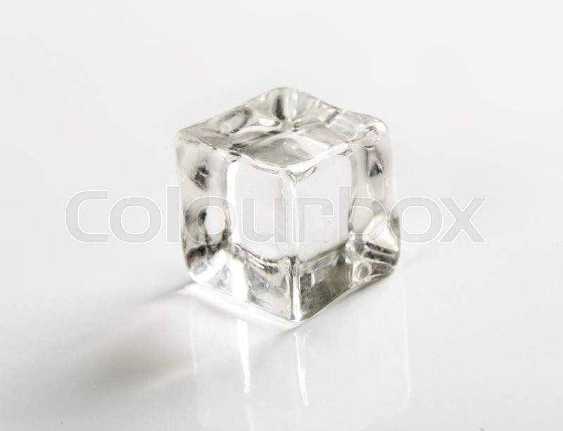 Stock image of 'Frozen water. Ice cube on the table'