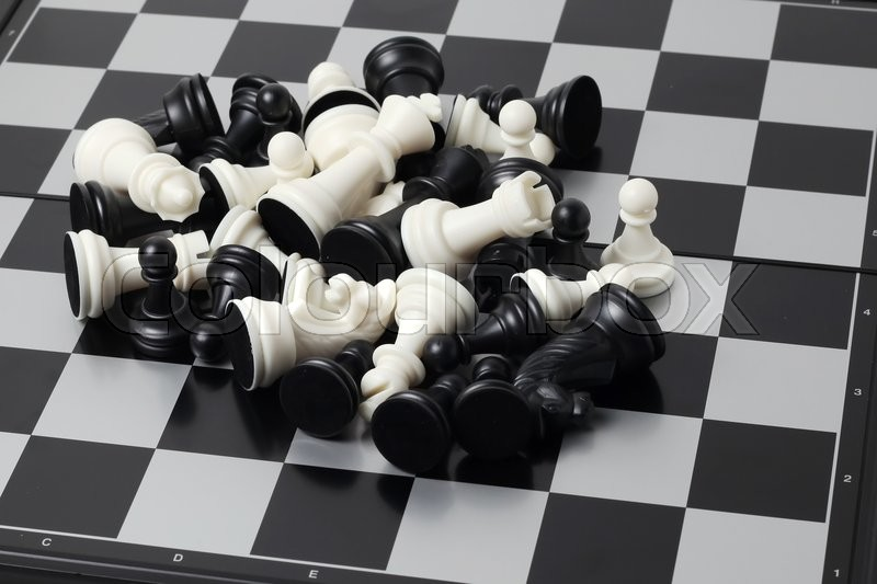 Stock image of 'Chess board with figures isolated on white background'