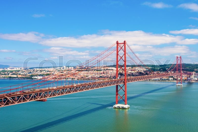 Stock image of 'The 25 de Abril Bridge is a bridge connecting the city of Lisbon to the municipality of Almada on the left bank of the Tejo river, Lisbon'