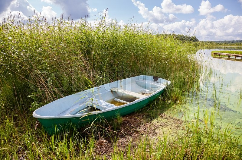 Stock image of 'Fishing boat at the lake in summer sunny day'