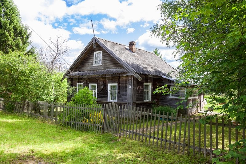 Stock image of 'Old wooden house in russian village. Novgorod region, Russia'