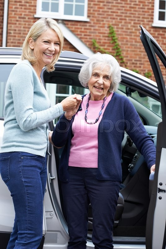 Stock image of 'Female Neighbor Giving Senior Woman A Lift In Car'