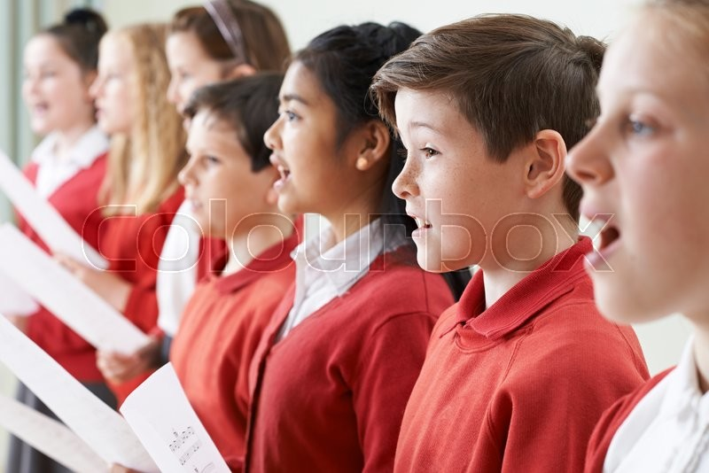 Stock image of 'Group Of Children Singing In School Choir'
