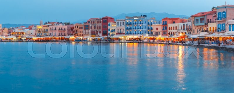 Stock image of 'Picturesque panoramic view of old harbour and Venetian quay of Chania during twilight blue hour, Crete, Greece'