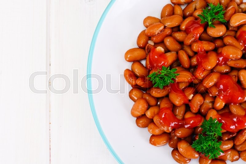 Stock image of 'Baked Beans with Tomato Paste and Parsley Studio Photo'